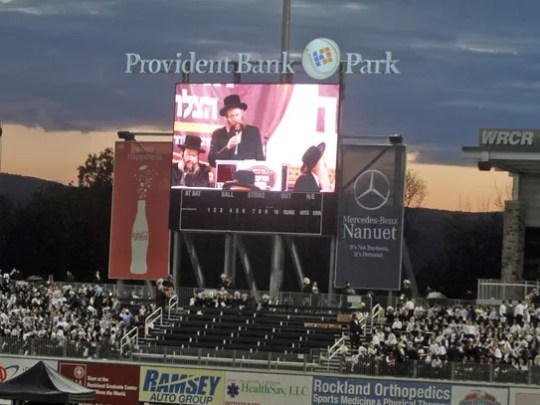 Hasidic men and boys packed Provident Bank Park in