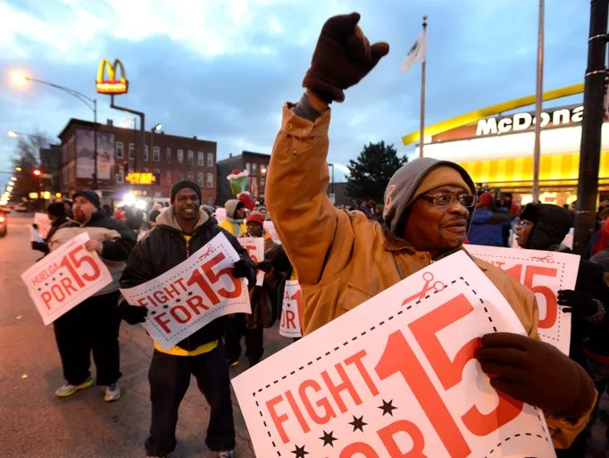 Demonstrators rally for better wages outside a McDonald's in Chicago.
