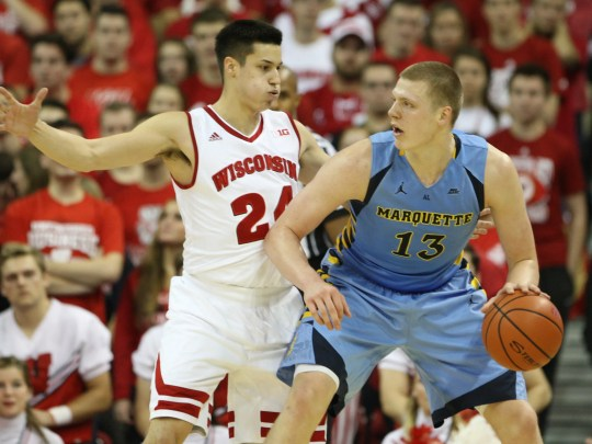 Marquette's Henry Ellenson looks to pass as Wisconsin's Bronson Koenig guards him. Both Ellenson and Koenig are Wisconsin natives.