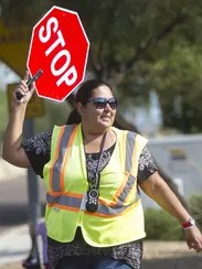 Nancy Munoz helps students and parents across the street