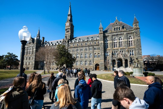 Prospective students and their parents on a campus tour of Georgetown University in Washington, DC, in March 2019.