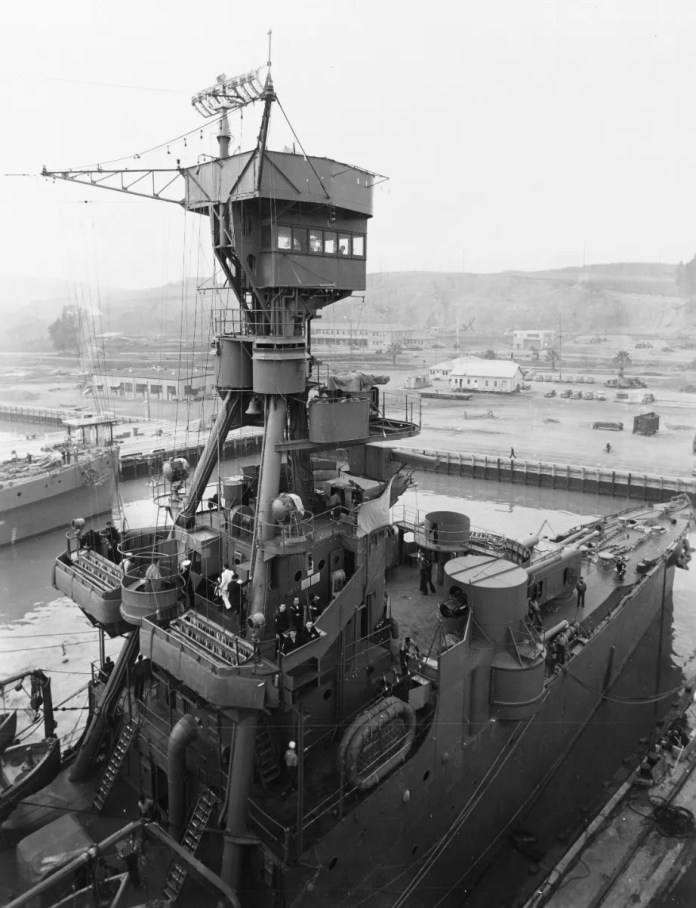 """The ship's forward superstructure and bow area featured a tripod foremast, signal flag bins and 6""""/53 guns in casemate mounts."""