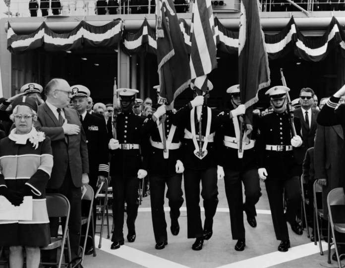 Sailors parade the colors at the commissioning ceremonies for the fifth USS Detroit at Puget Sound Naval Shipyard, March 28, 1970.
