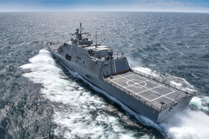 """Out on the USS Detroit's forecastle or helipad, the ship has the look of larger Navy vessels. The USS Detroit is part of a new breed of naval vessel, which operates with speed, agility and is, as one of its designers said, """"not like anything else out there."""""""