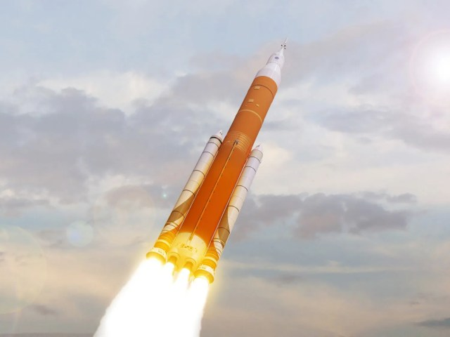 636332030920342477-sls-in-clouds-1- Scathing NASA report blasts SLS rocket and Boeing overruns; first launch likely to be delayed
