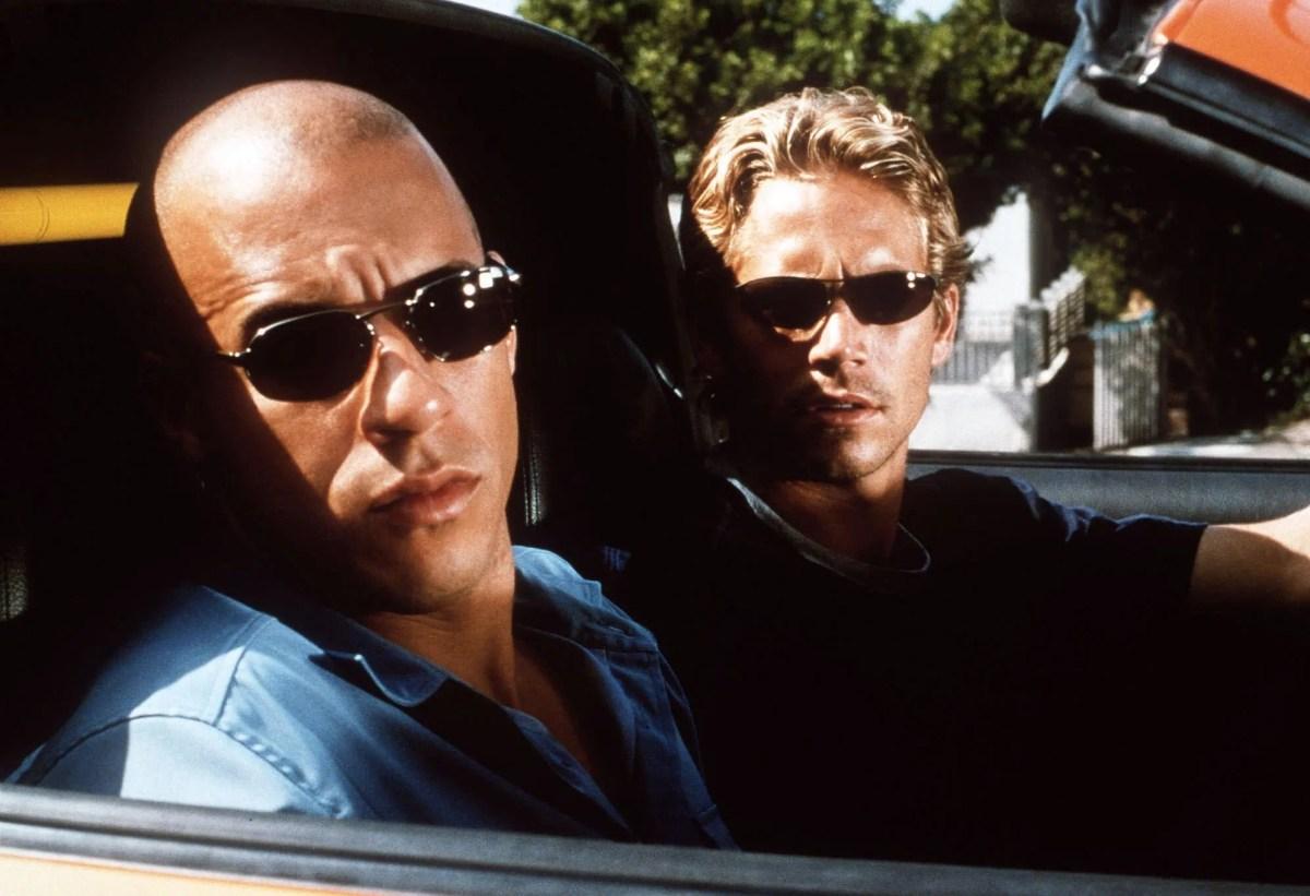 "Undercover cop Brian (Paul Walker) investigates rival street teams including leader Dominic (Vin Diesel) in ""Fast & Furious."""