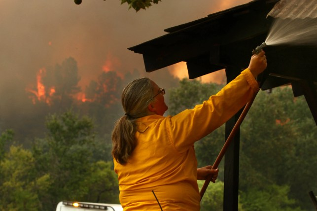 'It's moving faster than we can': Thousands evacuated; fire roars into Redding, California