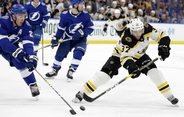 0abbf137404b4ccaaec0242a5679e2fe NHL win record in sight as Lightning rally past Bruins for 59th victory of season