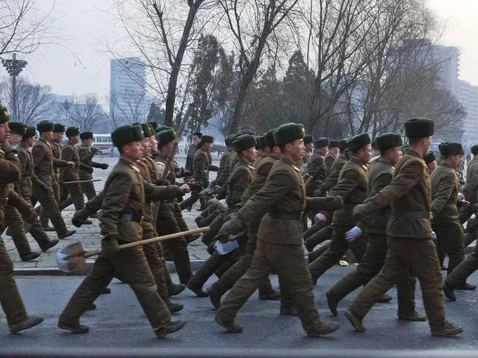 North Korean soldiers march through Pyongyang, the North Korean capital, on March 16.