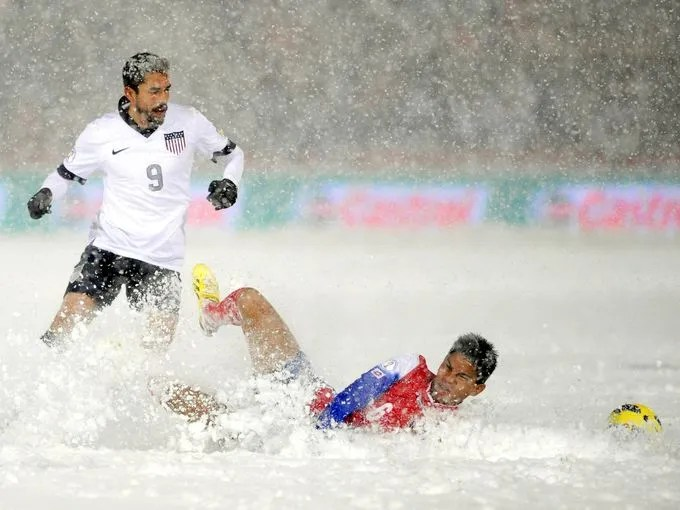 The U.S. men's national team topped Costa Rica 1-0 in a vital World Cup qualifier Friday at Dick's Sporting Goods Park in Commerce City, Colo. Here,Herculez Gomez looks for the ball as Costa Rica defender Juan Diego Madrigal falls in the snow.