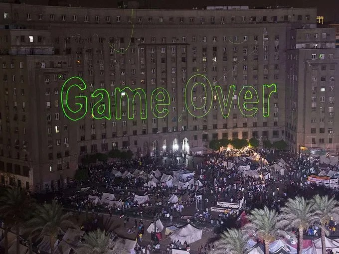 Laser lights on the wall of a government building spell out a message for President Morsi at Tahrir Square on July 2.