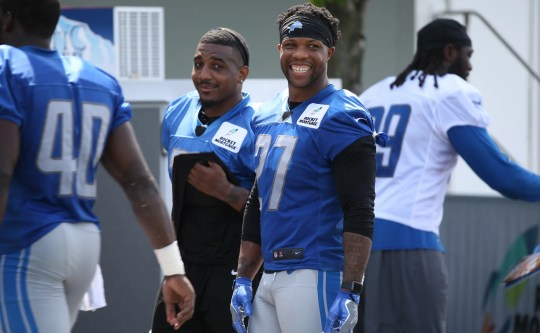 Glover Safety Quin talks with other players after the Detroit Lions training camp at their practice facility in Allen Park on Sat. July 28, 2018.