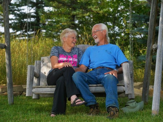 Darla Parker sits with her husband at their home in Ulm.  Parker was diagnosed with breast cancer for a second time, which has spurred life changes for her and her husband.  She incorporates walks, prayer and meditation as part of her daily wellness routine.