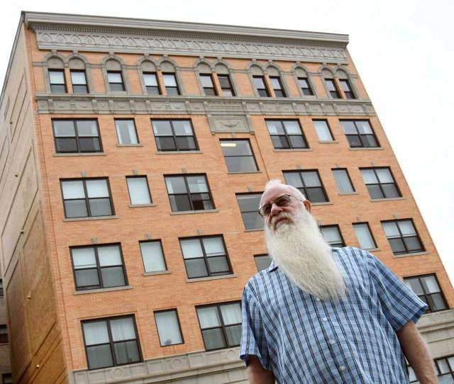 Patrick Dorn Executive Director For Cass Corridor Neighborhood Development Corp Talks About Cass Plaza Apartments Behind Him Empty For A Few Decades