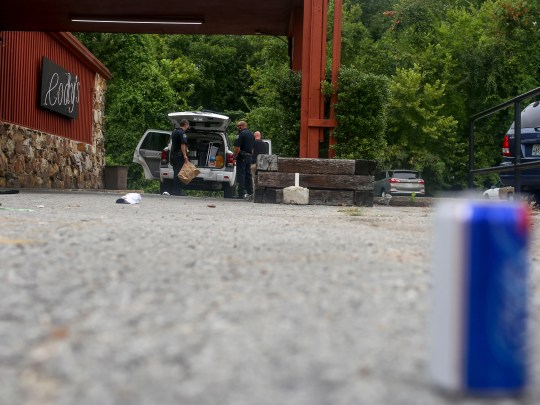 Jackson Police Department officers survey the scene of a shooting that took place in the early hours of Monday, August 20 at Cody's Saloon & Dance Hall in Jackson, Tenn., as shown on Monday, Aug. 20, 2018.