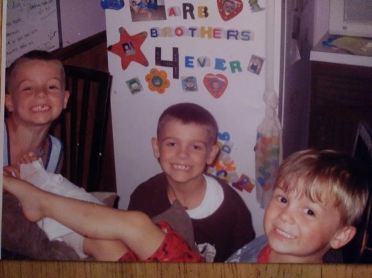 Razy Sellars, right, died by suicide in May. His brothers, Riley, left, and Rory, got messages on social media after Razy's death suggesting they too should kill themselves. This photo was taken about six years ago.