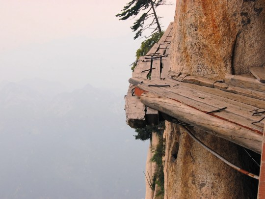 Dangerous walkways lead to the top of  Mount Hua Shan in Shaanxi province near Xi'an, China.