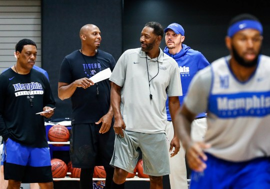 Memphis coaches (left to right) Tony Madlock, Penny Hardaway, Sam Mitchell and Mike Miller during an open practice Sept. 25.
