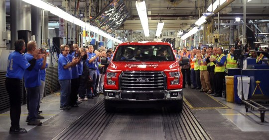 The first 2015 Ford F-150 truck leaves the assembly line of the Dearborn truck plant at the Ford Rouge Center on November 11, 2014 in Dearborn.