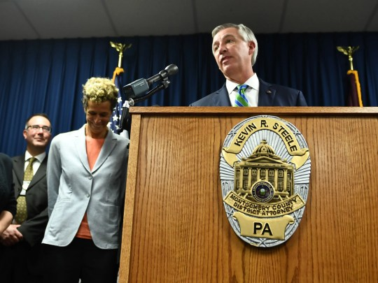 Montgomery County District Attorney Kevin Steele with Bill Cosby accuser Andrea Constand  on Sept. 25, 2018 in Norristown, Pa., after Cosby was sentenced to at three-to-10 years in prison.