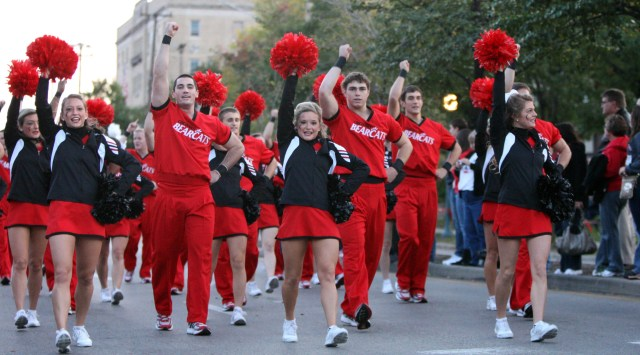 Cincinnati cheerleaders cheer for the crowd along Clifton Avenue as they march during University of Cincinnati Homecoming parade on October 14, 2011.