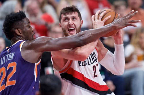 Oct 10, 2018; Portland, OR, USA; Portland Trail Blazers center Jusuf Nurkic (27) shoots over Phoenix Suns center Deandre Ayton (22) during the third quarter at the Moda Center.