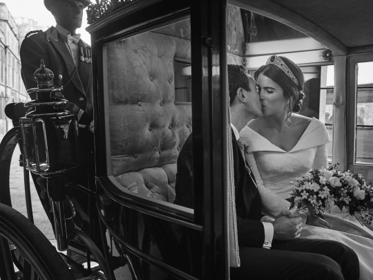 In this photo, on Saturday, October 13, 2018, Buckingham Palace, Britain's Princess Eugenie of York and Jack Brooksbank embrace, in the Scottish State Coach, after returning to Windsor Castle after the carriage procession after their wedding, in St. George's. s Chapel on Friday, October 12, 2018.