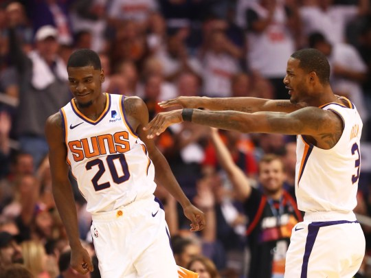 Josh Jackson and Trevor Ariza celebrate during the fourth quarter of the Suns' opener against the Mavericks at Talking Stick Resort Arena.