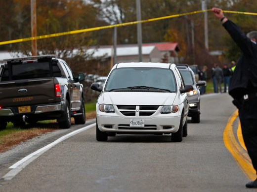 The Fulton County Coroner leaves with the bodies of three children killed near 4600 North IN State Rd. 25 north of Rochester, IN, where a pickup truck hit and killed the three young children and critically injured a fourth as the children crossed the street to get on a school bus, Tuesday, Oct. 30, 2018.  The bus was stopped with lights and stop indicators in use.