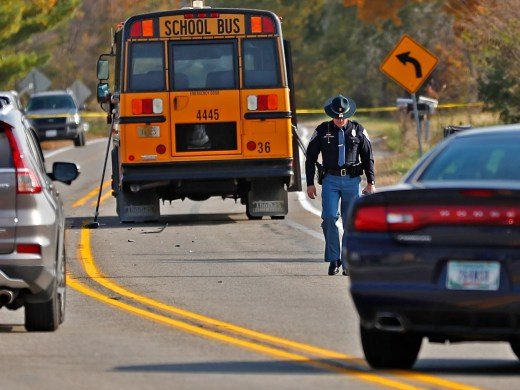 The scene is investigated on State Rd. 25 in Rochester, IN, where a pickup truck hit and killed three young children and critically injured a fourth as the children crossed the street to get on this school bus, Tuesday, Oct. 30, 2018.  The bus was stopped with lights and stop indicators in use.