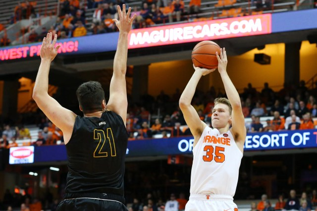 SYRACUSE, NY - OCTOBER 25:  Buddy Boeheim #35 of the Syracuse Orange shoots the ball against the defense of Jeff Allen #21 of the St. Rose Golden Knights during the first half at the Carrier Dome on October 25, 2018 in Syracuse, New York. (Photo by Rich Barnes/Getty Images)