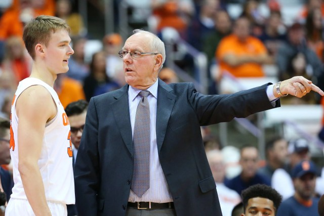 Syracuse freshman Buddy Boeheim, left, talks with his father, Syracuse head coach Jim Boeheim, on the sidelines during an exhibition game against the College of St. Rose in October.