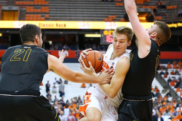 SYRACUSE, NY - OCTOBER 25:  Buddy Boeheim #35 of the Syracuse Orange drives to the basket against the defense of Jeff Allen #21 and Shane Herrity #12 of the St. Rose Golden Knights during the first half at the Carrier Dome on October 25, 2018 in Syracuse, New York. (Photo by Rich Barnes/Getty Images)