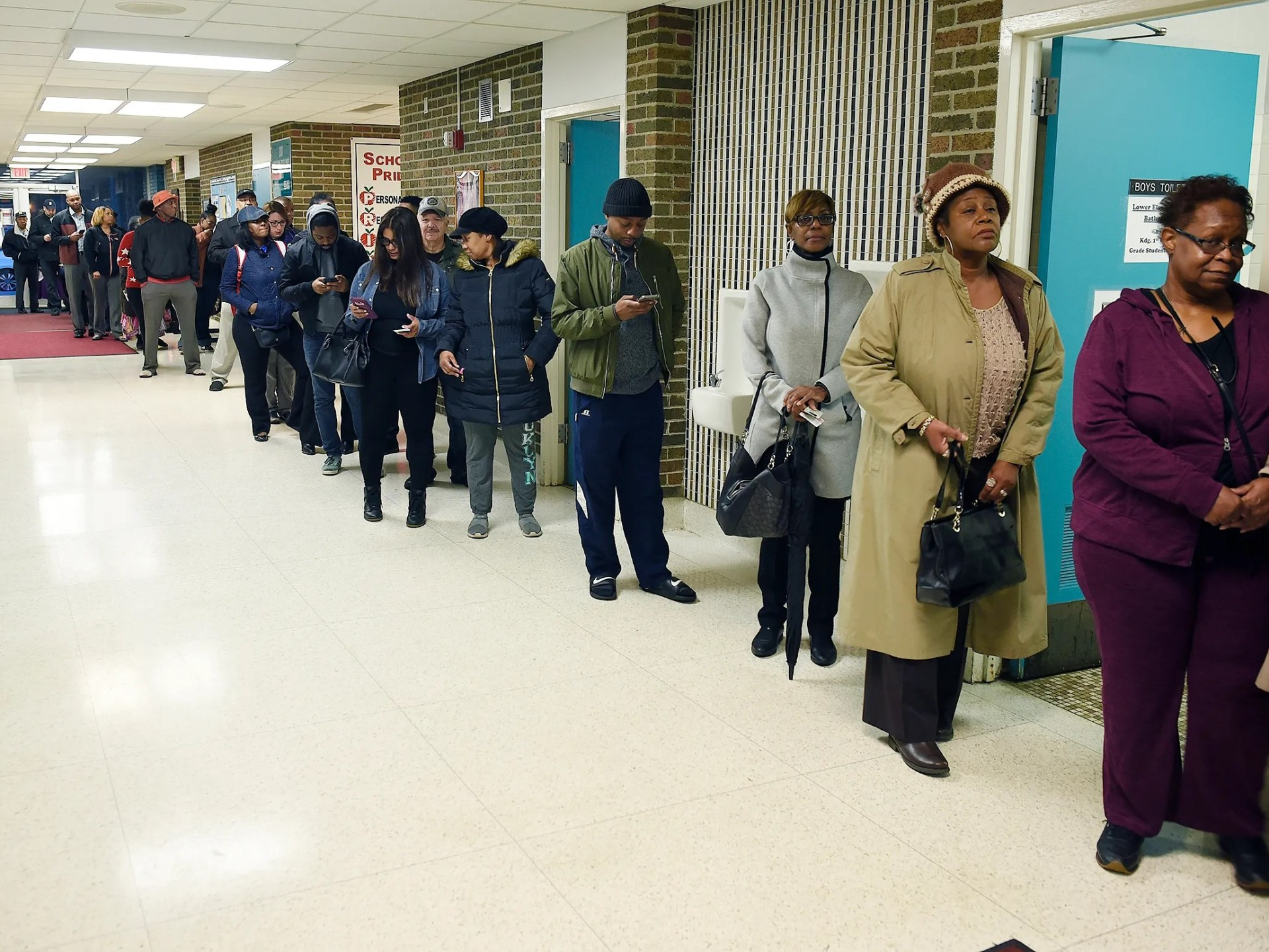 A long line of voters wait to vote Tuesday morning at Adler Elementary School in Southfield.