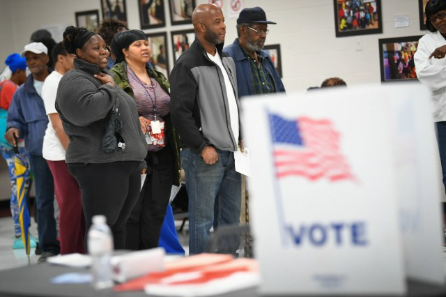 Voters wait in line to vote at Pittman Park Recreation center in Atlanta on Nov. 6, 2018, where some voters waited 3-4 hours due to only having three voting machines at the voting location.