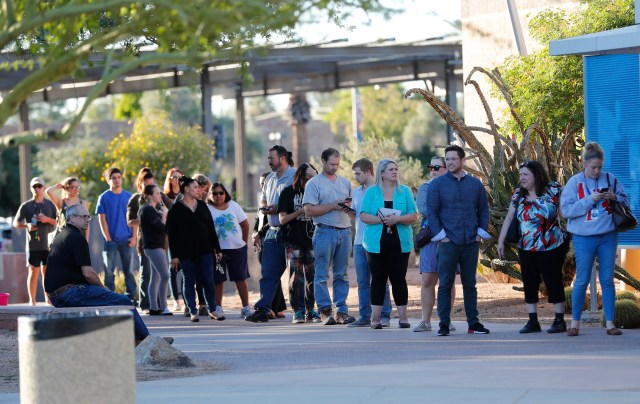 Voters wait in line to cast their ballots at a polling station at the Tempe History Museum in Ariz. Nov. 6, 2018.