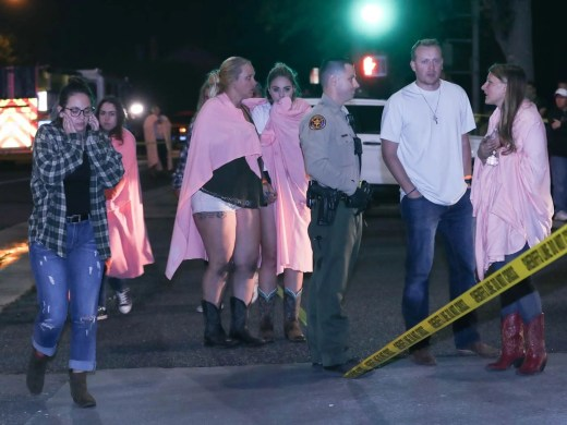 People comfort each other at the scene of a mass shooting at the Borderline Bar and Grill in Thousand Oaks, Calif., Nov. 8, 2018.