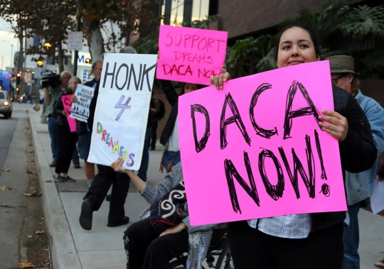 Demonstrators urging the Democratic Party to protect the Deferred Action for Childhood Arrivals (DACA) program rally outside the office of California Democratic Sen. Dianne Feinstein in Los Angeles in January.