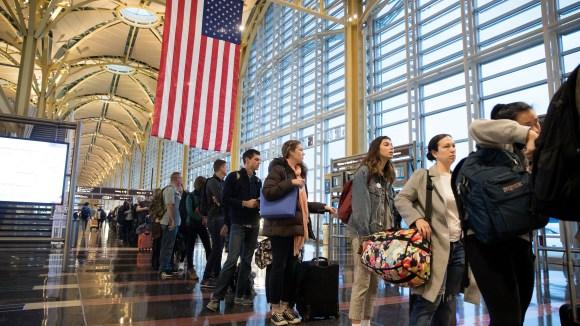 Travelers wait in line to go through security at Ronald Reagan Washington National Airport in Arlington, Virginia, on Nov. 22, 2017.