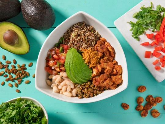 Tocaya Organica's shredded kale and quinoa salad tossed with white beans, avocado, chipotle-dusted almonds, chile lime pepitas seeds, pico de gallo and red-wine vinaigrette with adobo tofu.