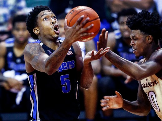 Memphis guard Kareem Brewton Jr. (left0 drives for a lay-up against College of Charleston defender Zep Jasper (right) during third day action in the Advocate Invitational in Orlando Sunday, November 25, 2018.