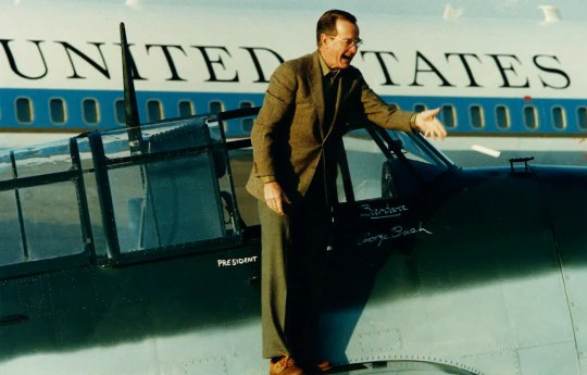Vice President/President-elect George H.W. Bush tosses a marker after naming the plane