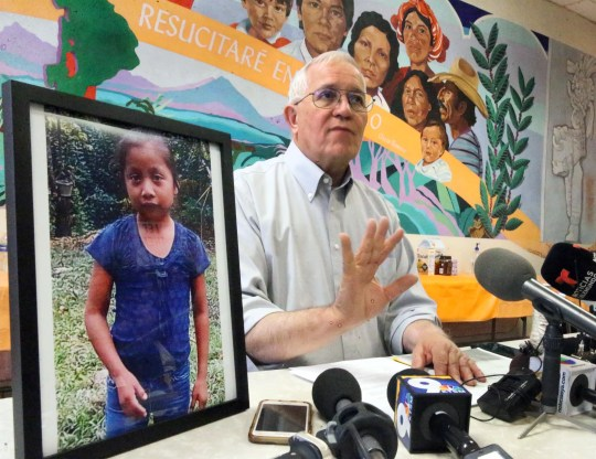 Annunciation House director Ruben Garcia answers questions from the media after reading a statement from the family of Jakelin Caal Maquin, pictured at left, during a news conference Saturday, Dec. 15, 2018, at Casa Vides in Downtown El Paso.