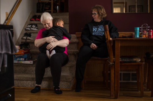 Kim Voelker-Wesley, 41, of Montrose embraces her son, Cameron Wesley, 3, while her mother Terrie Gronau of Montrose watches while sitting in the dining room of her home in Montrose, Thursday, January 3, 2019. Voelker-Wesley is battling skin cancer that has spread to the breast, lungs and liver after being in remission for five years. The disease has robbed of its livelihood and independence, but not its hopes. Has a resolution of one year: live.