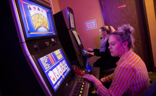 Stephanie Bucholz plays a video lottery games at Windjammers in Salem on Thursday, Jan. 3, 2019.