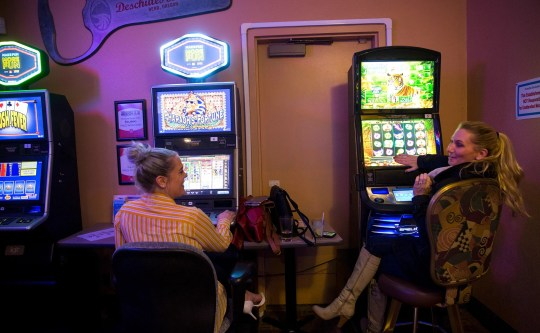 Stephanie Bucholz and Sarah Dupont play video lottery games at Windjammers in Salem on Thursday, Jan. 3, 2019.