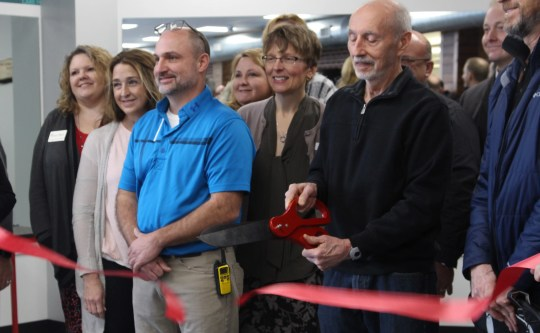 Don Witte cuts the ribbon to an approximately 2,000-square foot expansion to the Y's wellness center. The open space named after him saw its first visitors Thursday afternoon.