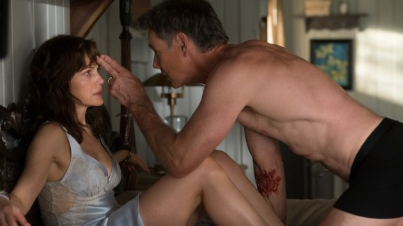 "Carla Gugino stars as a wife handcuffed to a bed and haunted by her dead husband (Bruce Greenwood) in ""Gerald's Game."""