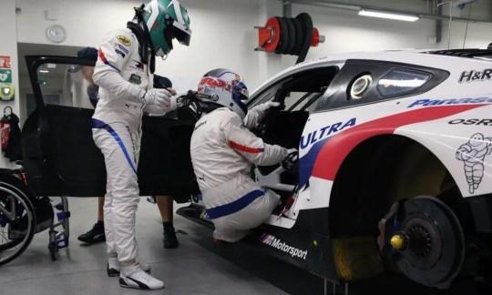 Alez Zanardi climbs into his sports car at Daytona International Speedway.