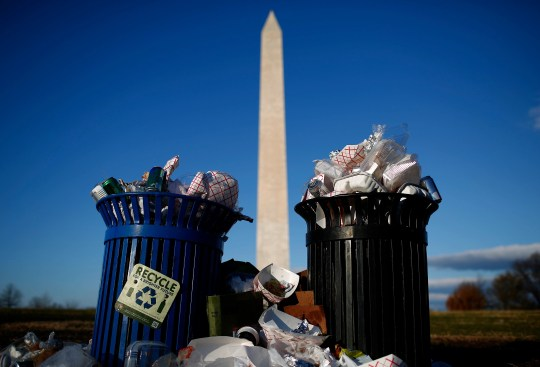 Trash begins to accumulate along the National Mall near the Washington Monument due to a partial shutdown of the federal government on Dec. 24, 2018 in Washington, DC.  All National Parks visitors centers remain closed as the shutdown continues after Congress and President Trump are at an impasse over the funding of the President's proposed southern border barrier.
